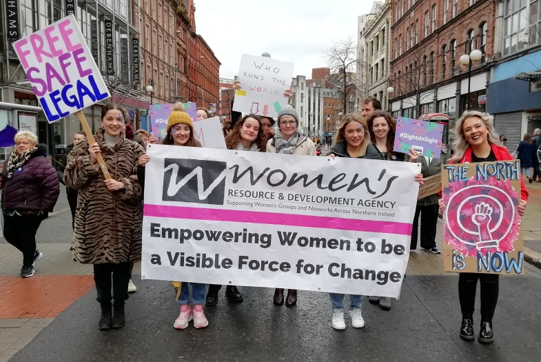 Women holding the WRDA banner.